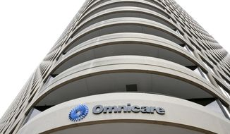 This May 21, 2015, photo, shows Omnicare Inc. headquarters in Cincinnati. Omnicare will pay more than $28 million to resolve allegations that the drug distributor accepted kickbacks for pushing an anti-seizure medication on doctors who were treating nursing home patients, the Department of Justice announced Monday, Oct. 17, 2016.  (Kareem Elgazzar/The Cincinnati Enquirer via AP)