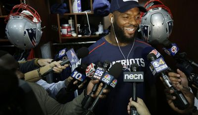 FILE - This Sept. 28, 2016 file photo shows New England Patriots tight end Martellus Bennett taking questions from members of the media in the teams locker room before an NFL football team practice in Foxborough, Mass. The Patriots had a vision of what could be when they acquired Martellus Bennett in a trade with the Bears this spring. (AP Photo/Steven Senne, file)
