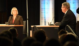 Senator Patty Murray, left, listens to challenger Chris Vance, right, make a point during their debate Sunday, Oct. 16, 2016 at Gonzaga University, in Spokane, Wash.  (Jesse Tinsley/The Spokesman-Review via AP)