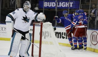 San Jose Sharks goalie Martin Jones (31) reacts as the against New York Rangers celebrate a goal by Rick Nash during the second period of an NHL hockey game, Monday, Oct. 17, 2016, in New York. (AP Photo/Frank Franklin II)