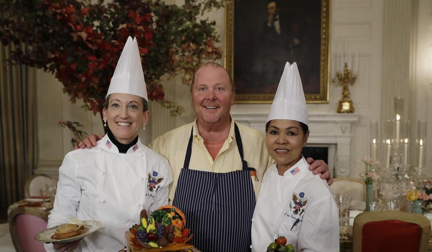 From left, White House Executive Pastry Chef Susan Morrison, American chef Mario Batali, and White House Executive Chef Cris Comerford pose for photographers during a preview in advance of the State Dinner in honor of the Official Visit of Italian Prime Minister Matteo Renzi and his wife Agnese Landini, Monday, Oct. 17, 2016, in the State Dining Room of the White House in Washington. (AP Photo/Carolyn Kaster)