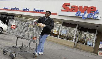 FILE - In this April 12, 2011 file photo, shopper Andrew Boston leaves the Save-a-Lot grocery store with his purchases in Northfield, Ohio. Supervalu said Monday, Oct. 17, 2016 that it is selling its Save-A-Lot supermarket chain for $1.37 billion to Canadian private equity firm Onex Corp. The deal is expected to close before the end of January.  (AP Photo/Amy Sancetta, File)