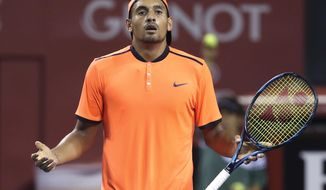 FILE - In this Saturday, Oct. 8, 2016, file photo, Australia's Nick Kyrgios reacts after getting a point against Gael Monfils of France during the semifinal match of Japan Open tennis championships in Tokyo.  The ATP has suspended Nick Kyrgios for at least 3 weeks and fined him extra $25,000 for conduct contrary to 'integrity' of tennis.  (AP Photo/Koji Sasahara, File)