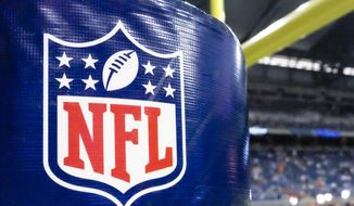 FILE - This Aug. 9, 2014 file photo shows an NFL logo on a goal post padding before a preseason NFL football game between the Detroit Lions and the Cleveland Browns at Ford Field in Detroit. Sports Illustrated reported in October 2016 that the NFL is strictly limiting its teams from sharing their own video or animated GIFs of highlights. With that in mind, the Eagles and Browns got creative on their Twitter accounts Sunday, Oct. , 2016. The Browns used a video of toy electric football-style players to celebrate on Twitter after a touchdown. The Eagles used a similar video to show an interception, complete with a homemade sign. (AP Photo/Rick Osentoski, File)