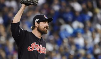 Cleveland Indians' Andrew Miller (24)celebrates his team's victory over the Toronto Blue Jays in game three American League Championship Series baseball action in Toronto on Monday, Oct. 17, 2016. (Nathan Denette/The Canadian Press via AP)