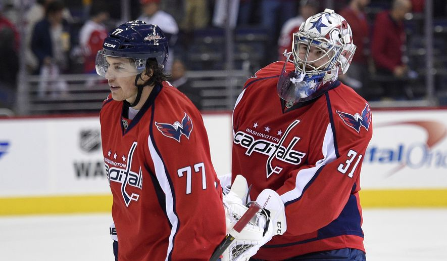 Capitals goalie Philipp Grubauer taps T.J. Oshie as they leave the ice after the team's 3-0 win over the Colorado Avalanche on Tuesday in Washington. (Associated Press)
