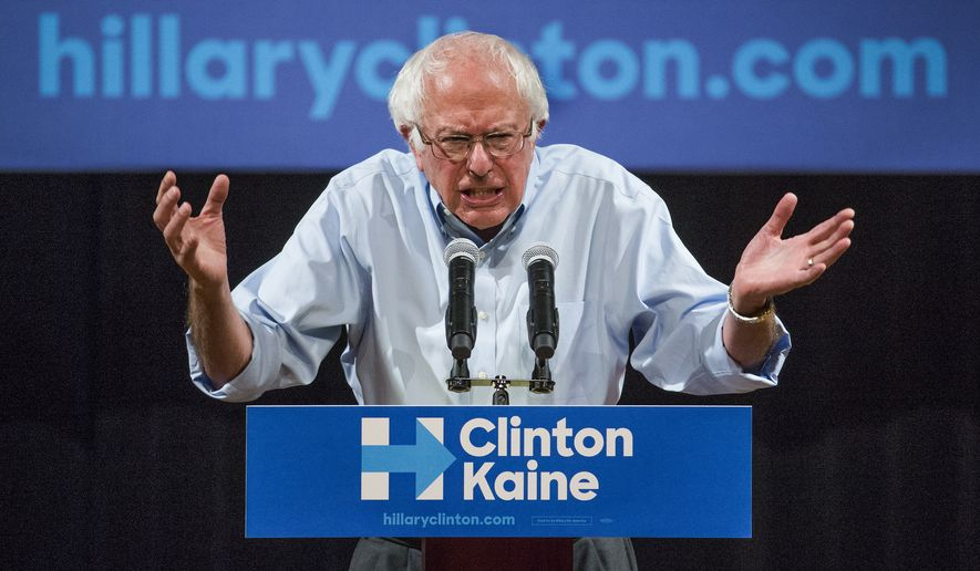 Bernie Sanders addresses a Clinton-Kaine rally inside the Prochnow Auditorium at Northern Arizona University, Tuesday, Oct. 18, 2016.  Many political observers believe that traditionally Republican Arizona is in play for this election. (Tom Tingle/The Arizona Republic via AP)