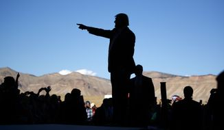 Republican presidential candidate Donald Trump arrives to speak at a campaign rally, Tuesday, Oct. 18, 2016, in Grand Junction, Colo. (AP Photo/ Evan Vucci)