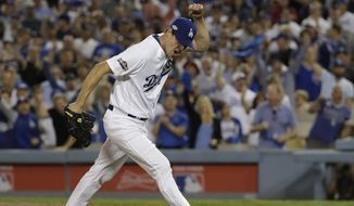 Dodgers starting pitcher Rich Hill reacts after striking out Anthony Rizzo of the Cubs in the sixth inning of Game 3 of the NLCS Tuesday in Los Angeles. (Associated Press)