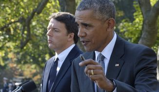 President Barack Obama, accompanied by Italian Prime Minister Matteo Renzi, speaks during their joint news conference in the Rose Garden of the White House in Washington, Tuesday, Oct. 18, 2016. (AP Photo/Susan Walsh)