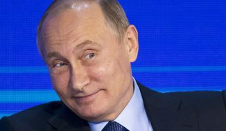 Russian President Vladimir Putin grimaces as he attends the Business Russia Congress in Moscow, Russia, Tuesday, Oct. 18, 2016. Putin said that Russia would offer more freedom to private business to help offset the impact of Western sanctions.(AP Photo/Alexander Zemlianichenko, pool)