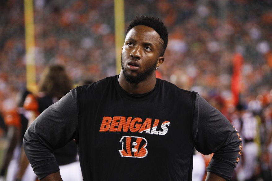FILE - In this Aug. 29, 2015, file photo, Cincinnati Bengals offensive tackle Cedric Ogbuehi stands on the sidelines in the first half of an NFL preseason football game against the Chicago Bears, in Cincinnati. Ogbuehi got benched once in college for a subpar play. It happened again during the Bengals' loss in New England as the first-year starter struggled. He expects to be back in the lineup against Cleveland on Sunday. (AP Photo/Frank Victores, File)
