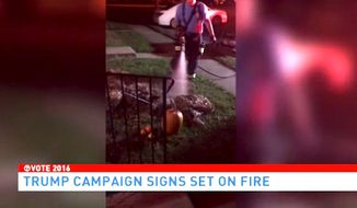 Police in Fredericksburg, Virginia, are searching for the person responsible for setting fire to a pro-Donald Trump display that sat just a few feet from a row of townhouses. (WJLA)