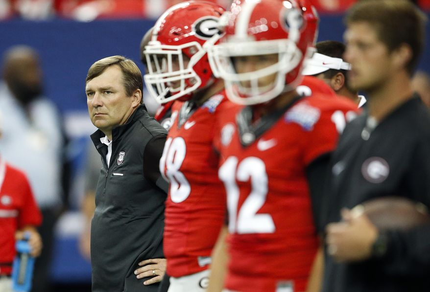 FILE - In this Sept. 3, 2016, file photo, Georgia head coach Kirby Smart looks on as his team warms up before an NCAA college football game against North Carolina, in Atlanta. The Bulldogs have the week off to try and figure how they can end a two-year skid against Florida.  (AP Photo/John Bazemore, File)