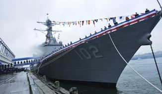 FILE - In this Nov. 3, 2007 file photo, navy personnel line the deck of the Arleigh Burke-class guided-missile destroyer USS Sampson during a commissioning ceremony in Boston. The U.S. Navy warship will visit New Zealand next month for the first time since the 1980s, ending a 30-year-old military stalemate between the countries that was triggered when New Zealand banned nuclear warships. New Zealand Prime Minister John Key announced Tuesday, Oct. 18, 2016, that he had given clearance for the destroyer USS Sampson to visit during celebrations marking the Royal New Zealand Navy's 75th anniversary. (AP Photo/Lisa Poole, File)
