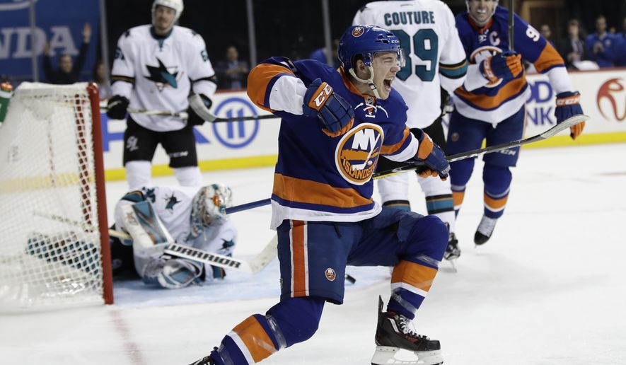 New York Islanders' Anthony Beauvillier (72) celebrates after scoring his first career goal as San Jose Sharks goalie Aaron Dell gets up during the second period of an NHL hockey game, Tuesday, Oct. 18, 2016, in New York. (AP Photo/Frank Franklin II)