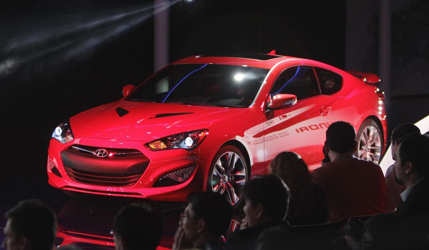 FILE - In a Jan. 9, 2012 file photo, the Hyundai Genesis Coupe is unveiled at the North American International Auto Show in Detroit. Hyundai is recalling more than 84,000 cars in the U.S. because a wiring problem can cause the front passenger air bag to malfunction. The recall covers Genesis Coupes from the 2010 to 2016 model years.  (AP Photo/Carlos Osorio, File)