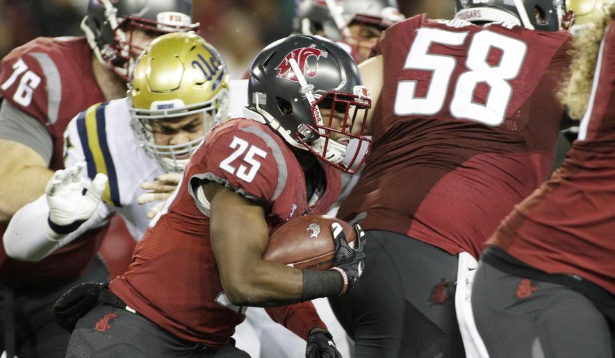 FILE - In this Oct. 15, 2016, file photo, Washington State running back Jamal Morrow (25) carries the ball during the second half of an NCAA college football game against UCLA in Pullman, Wash. Washington State's four-game win streak and return to contention in the Pac-12 can be attributed to the Cougars determination to run the ball on offense.  (AP Photo/Young Kwak, File)