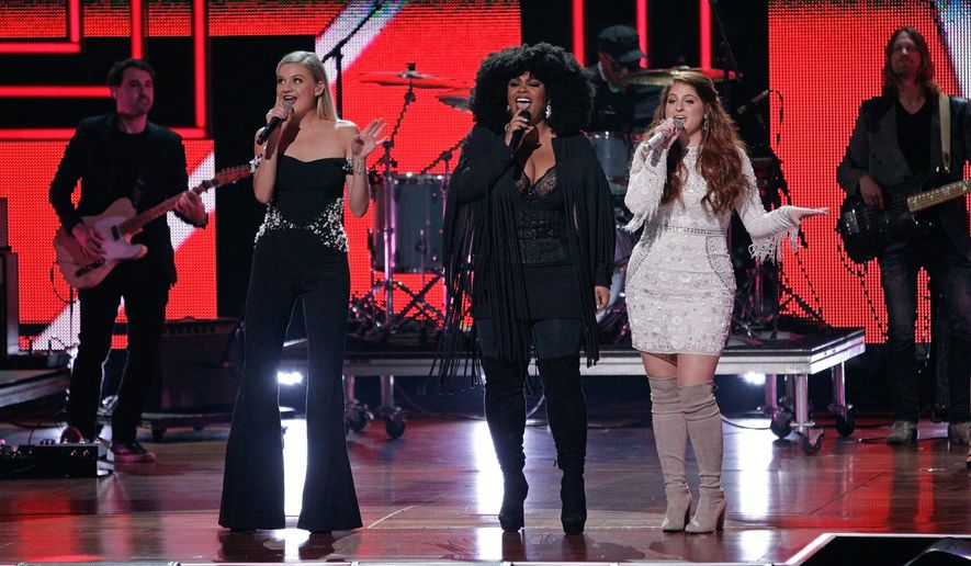 Kelsea Ballerini, from left, Jill Scott and Meghan Trainor perform a tribute to Shania Twain during the CMT Artists of the Year awards show at the Schermerhorn Symphony Center on Wednesday, Oct. 19, 2016, in Nashville, Tenn. (Photo by Wade Payne/Invision/AP)