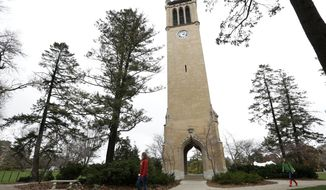In this Oct. 25, 2012, file photo ,students walk past the Campanile on the Iowa State University campus in Ames, Iowa. (AP Photo/Charlie Neibergall, File)