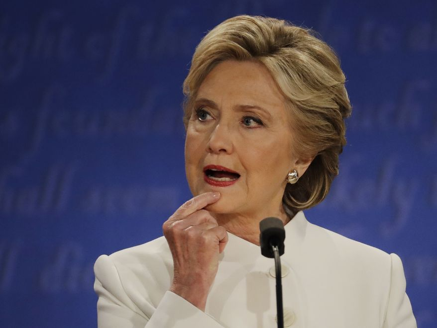 Hillary Clinton listens to Donald Trump during the third presidential debate Wednesday in Las Vegas. (Associated Press)