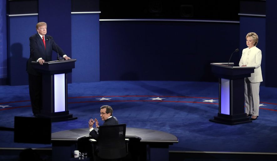 Moderator Chris Wallace turns toward the audience as he questions Hillary Clinton and Donald Trump during the third presidential debate Wednesday in Las Vegas. (Associated Press)