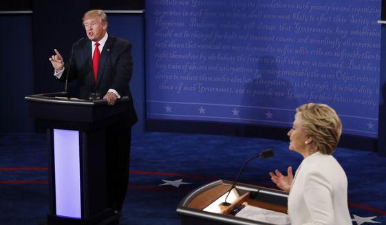 Republican presidential nominee Donald Trump debates with Democratic presidential nominee Hillary Clinton during the third presidential debate at UNLV in Las Vegas, Wednesday, Oct. 19, 2016. (Mark Ralston/Pool via AP)