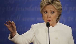Democratic presidential nominee Hillary Clinton responds to Republican presidential nominee Donald Trump during the third presidential debate at UNLV in Las Vegas, Wednesday, Oct. 19, 2016. (AP Photo/Patrick Semansky)