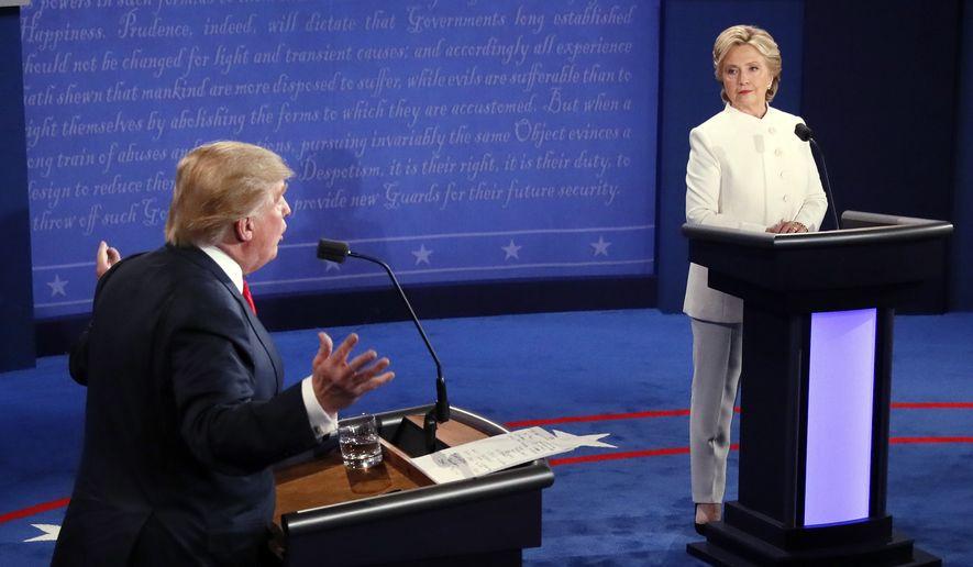 Democratic presidential nominee Hillary Clinton and Republican presidential nominee Donald Trump debate during the third presidential debate at UNLV in Las Vegas, Wednesday, Oct. 19, 2016. (Mark Ralston/Pool via AP)