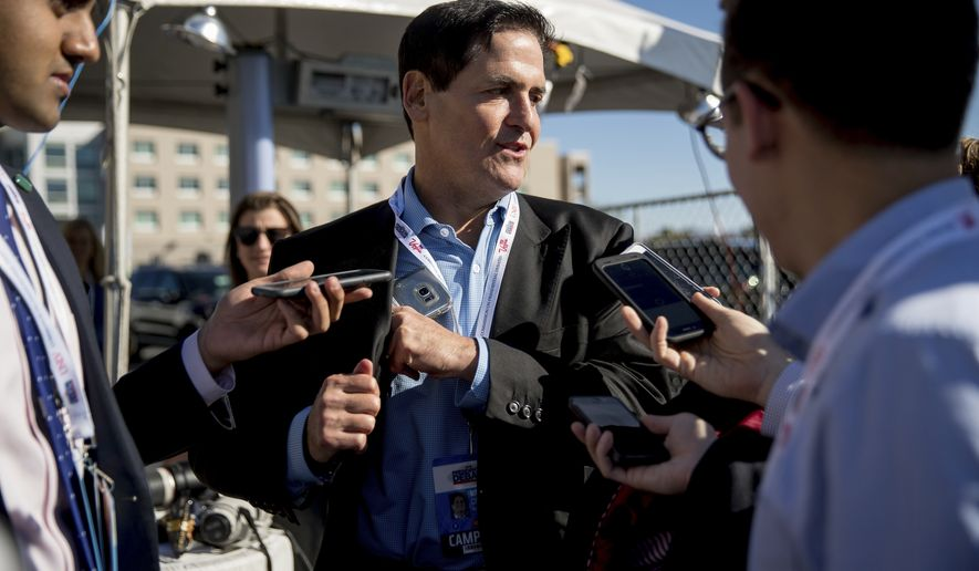Businessman Mark Cuban stops to speak with members of the media as he arrives for the third presidential debate between Democratic presidential candidate Hillary Clinton and Republican presidential candidate Donald Trump at University of Nevada in Las Vegas, N.Y., Wednesday, Oct. 19, 2016. (AP Photo/Andrew Harnik)