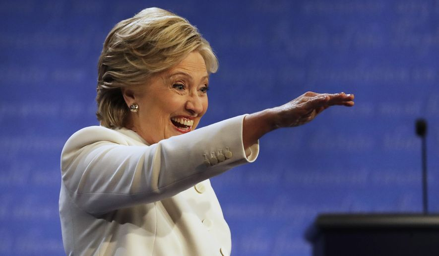 Democratic presidential nominee Hillary Clinton waves to guests following the third presidential debate with Republican presidential nominee Donald Trump at UNLV in Las Vegas, Wednesday, Oct. 19, 2016. (AP Photo/Patrick Semansky)
