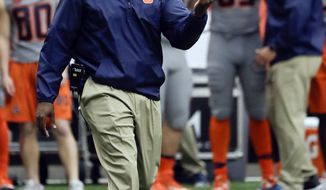 FILE - In this Saturday, Oct. 15, 2016, file photo, Syracuse head coach Dino Babers signals to players during the first half of an NCAA college football game against the Virginia Tech on in Syracuse, N.Y. Babers is rocking the locker room speech after beating Virginia Tech and knocking the Hokies out of the Top 25. (AP Photo/Mike Groll, File)