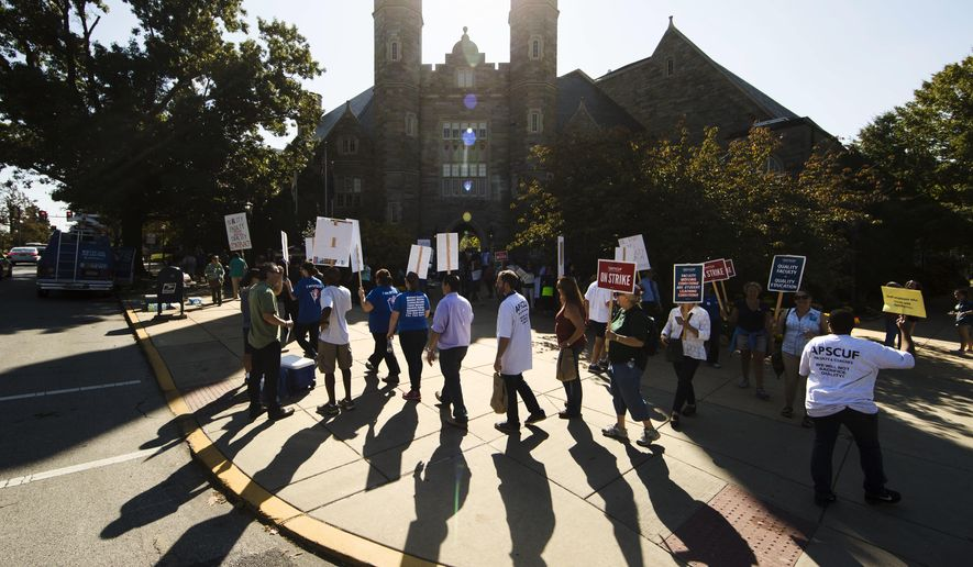 Faculty and their supporters demonstrate at West Chester University in West Chester, Pa., Wednesday, Oct. 19, 2016. Faculty at Pennsylvania state universities went on strike Wednesday morning, disrupting classes midsemester after contract negotiations hit an impasse. (AP Photo/Matt Rourke)