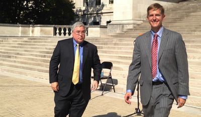 West Virginia Attorney General Patrick Morrisey, left, and Democratic challenger Doug Reynolds walk away after their debate outside the West Virginia Capitol on Wednesday, Oct. 19, 2016, in Charleston, W.Va. (AP Photo/John Raby)