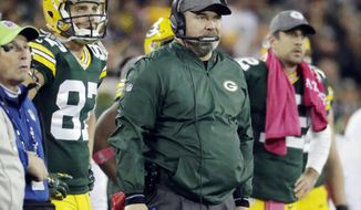 FILE - In this Oct. 9, 2016 file photo, Green Bay Packers head coach Mike McCarthy watches an NFL football game against the New York Giants in Green Bay, Wis. The NFL's oldest rivalry will be renewed on Thursday, Oct. 20, 2016, when the Chicago Bears visit the Packers. It's the 193rd meeting between the NFC North rivals. (AP Photo/Morry Gash, File)