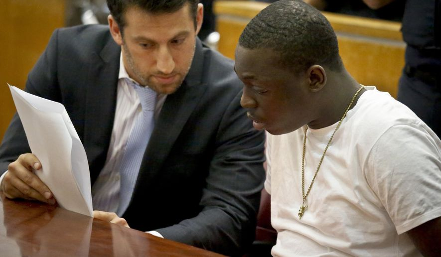 "Rapper Bobby Shmurda, whose birth name is Ackquille Pollard, right, confers with his lawyer Alex Spiro in a Manhattan court on Wednesday Oct. 19, 2016, in New York. Shmurda, best known for ""Hot Boy,"" a gritty hit song with rhymes about street violence, was sentenced to seven years in prison on charges he conspired with a drug gang in several shootings. (AP Photo/Bebeto Matthews)"
