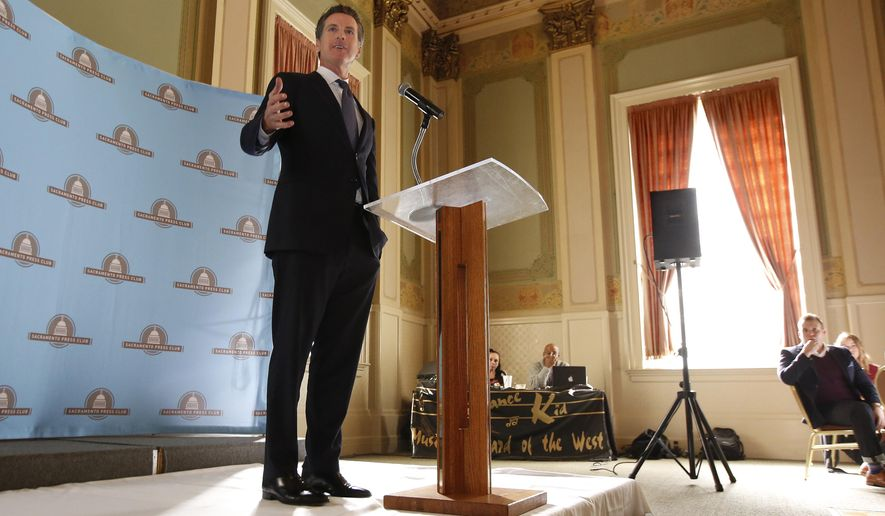 """Lt. Gov. Gavin Newsom says he no longer opposes California's $64 billion high-speed rail plan while speaking at the Sacramento Press Club in Sacramento, Calif., Wednesday, Oct. 19, 2016. Newsom said he would """"100 percent"""" seek a solid funding source for the train project if he's elected governor in 2018. (AP Photo/Rich Pedroncelli)"""