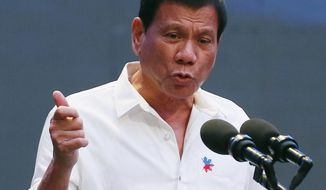 FILE - In this Oct. 13, 2016 file photo, Philippine President Rodrigo Duterte gestures during his address to a Filipino business sector in suburban Pasay city south of Manila, Philippines. This week's visit to China by Duterte points toward a restoration of trust between the sides following recent tensions over their South China Sea territorial dispute, China's official news agency said Tuesday, Oct. 18. (AP Photo/Bullit Marquez, File)