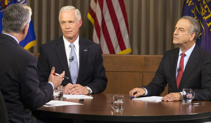 CORRECTS YEAR TO 2016-Republican U.S. Sen. Ron Johnson, left, and Democrat Russ Feingold, right, meet in their second and final debate  Tuesday, Oct. 18, 2016 in Milwaukee. The debate was moderated by Mike Gousha. (Mark Hoffman/Milwaukee Journal-Sentinel via AP)