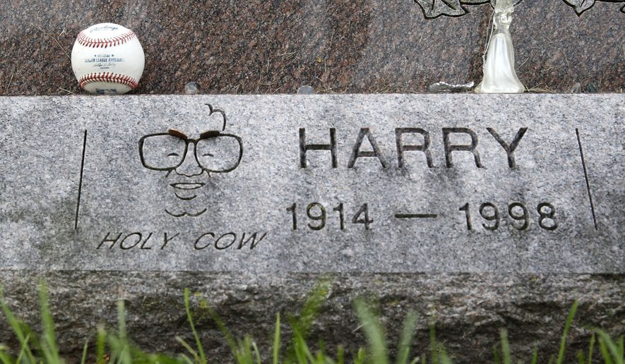 A baseball sits on the grave stone of famed Chicago Cubs broadcaster Harry Carey at All Saints Cemetery Wednesday, Oct. 19, 2016, in Des Plaines, Ill. In a city where fans have been known to scatter ashes of the dearly departed at Wrigley Field, families of those who could no longer wait 'till next season are planting Cubs pennants and flags at the graves of loved ones or sending them off to the great beyond with Cubs hats and jerseys in their caskets. (AP Photo/Charles Rex Arbogast)