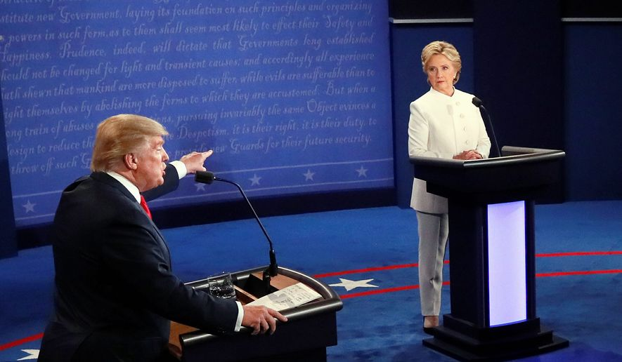Donald Trump gestures toward Hillary Clinton during the third presidential debate Wednesday in Las Vegas. (Associated Press) ** FILE **
