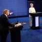 Donald Trump gestures toward Hillary Clinton during the third presidential debate Wednesday in Las Vegas. (Associated Press) ** FILE **