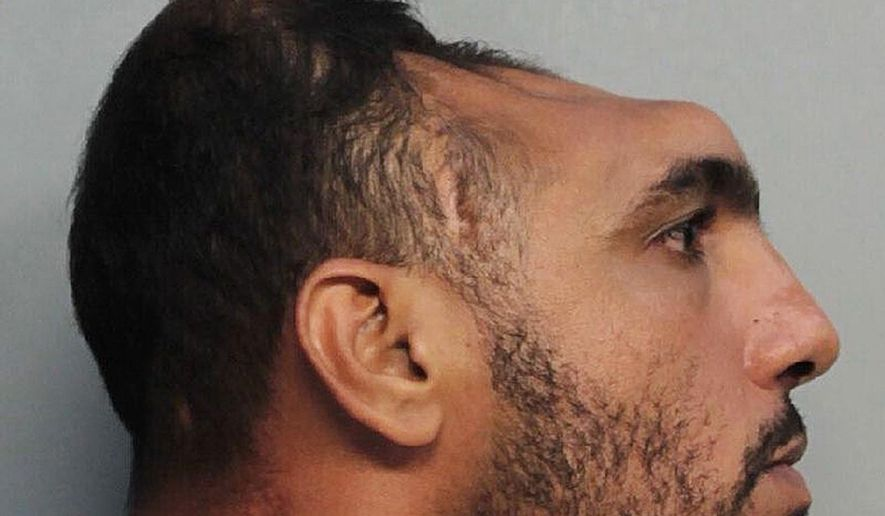 """This Monday, Oct. 17, 2016, photo provided by the Miami-Dade Corrections and Rehabilitation Department shows Carlos Rodriguez, who is facing arson and attempted first-degree murder charges. Investigators said Rodriguez told them he set a mattress on fire, adding he wanted to burn the house down so he could build a new, """"two-story house."""" (Miami-Dade Corrections and Rehabilitation Department via AP)"""