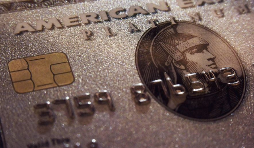 FILE - This Tuesday, Oct. 4, 2016, file photo shows a mockup of an American Express Platinum Card provided by the company, in New York. American Express reports financial results Wednesday, Oct. 19, 2016. (AP Photo/Patrick Sison, File)