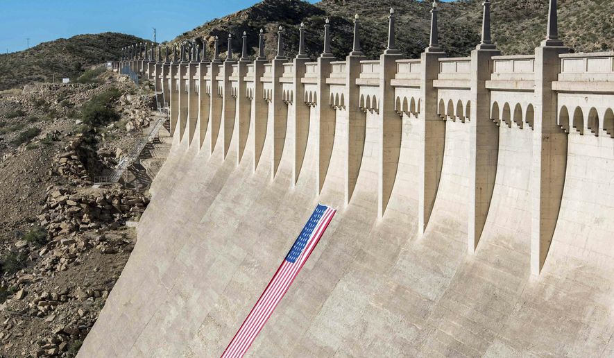 This photo provided by the Bureau of Reclamation shows an American flag displayed on Elephant Butte Dam as part of a centennial celebration near Truth or Consequences, N.M., Wednesday, Oct. 19, 2016. (Alexander Stephens/Bureau of Reclamation via AP)