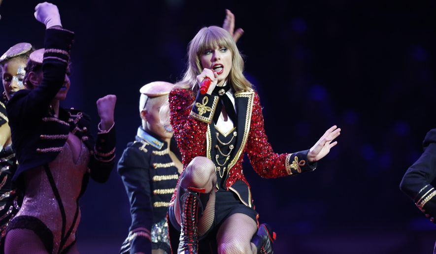 FILE - In this Nov. 11, 2012, file photo, US singer Taylor Swift performs during the 2012 MTV European Music Awards show at the Festhalle in Frankfurt, central Germany. With the promise of blue skies and some sizzling pop from Taylor Swift, the U.S. Grand Prix is indeed back after all those worries about its potential demise. There's even a title chase on the track at the Circuit of the Americas.  (AP Photo/Michael Probst, File)