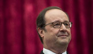 """FILE- In this Sunday, Oct. 2016 file photo, French President Francois Hollande stands during a meeting with International Olympic Committee President Thomas Bach at the Elysee Palace in Paris. Normally a man of consensus and caution, President Francois Hollande's frank comments in a new book written by two journalists is causing shockwaves in France. """"A President Shouldn't Say That ..."""" has exposed the inner workings of Hollande's troubled presidency and his views on Islamic veils, Barack Obama and his private life. (AP Photo/Kamil Zihnioglu, Pool, File)"""