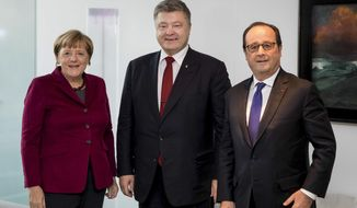 German Chancellor Angela Merkel, left, President of Ukraine Petro Poroshenko, centre, and and French President Francois Hollande pose for a picture prior a summit with the leaders of Russia, Ukraine and France at the chancellery in Berlin, Wednesday, Oct. 19, 2016. (Mikhail Palinchak/Pool Photo via AP)