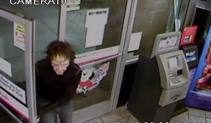 This image from Friday, Oct. 14, 2016, surveillance video provided by the Scottsdale Arizona Police Department shows a man who wore a zombie-clown type mask and carried a real hatchet while robbing a convenience store in Scottsdale, Ariz., as the police seek the public's help in finding the man. (Scottsdale Police Department via AP)