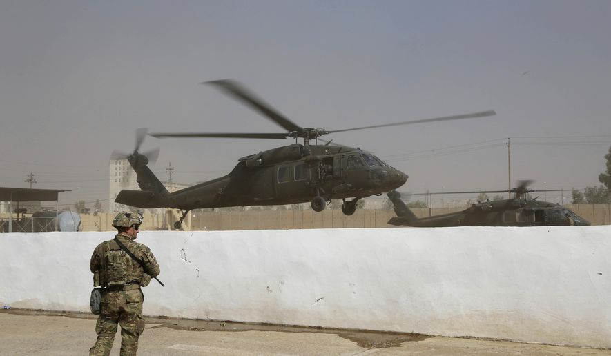 A helicopter belonging to the international coalition forces takes off from a base outside Mosul, Iraq, Wednesday, Oct. 19, 2016. (AP Photo) ** FILE **